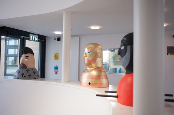 Big Heads in Reception (side view)